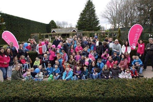 Images shows a group of SWAN UK families at Peppa Pig World.