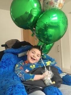 Hugh with green balloons
